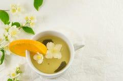 Green tea with jasmine leaf in a cup Stock Photos