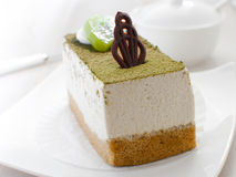Green tea and kiwi decorated cake Stock Images