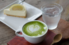 Green tea Latte and lemon cake Stock Photo