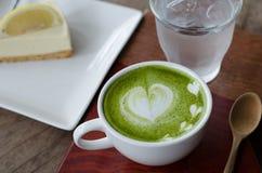 Green tea Latte and lemon cake Stock Photos