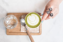 Green tea latte on wood background. In the coffee shop Royalty Free Stock Images