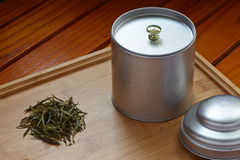 Green tea leaf and metal can Royalty Free Stock Photo