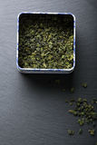 Green tea leaves in box Royalty Free Stock Images