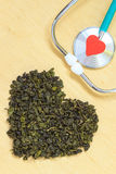 Green tea leaves heart shaped and stethoscope Royalty Free Stock Image
