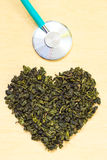 Green tea leaves heart shaped and stethoscope Royalty Free Stock Images