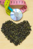 Green tea leaves heart shaped and stethoscope Stock Image