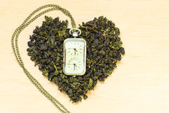 Green tea leaves heart shaped and watch Royalty Free Stock Image
