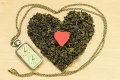 Green tea leaves heart shaped and watch Royalty Free Stock Photography