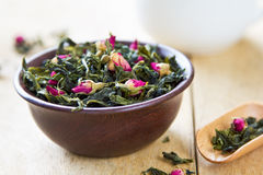 Green tea leaves with rose buds Stock Images