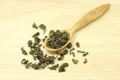 Green tea leaves in wooden spoon Royalty Free Stock Photo