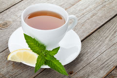 Green tea with lemon and mint on wooden table Royalty Free Stock Photography