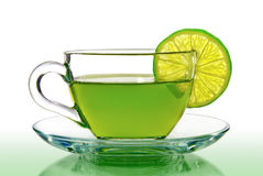 Green tea with lemon on a white background.  Stock Image
