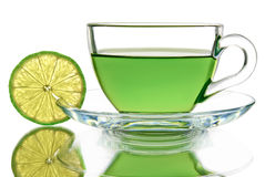Green tea with lemon on a white background Royalty Free Stock Images