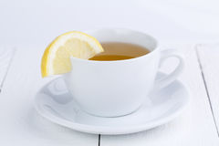 Green tea with lemon on wooden table. Stock Image
