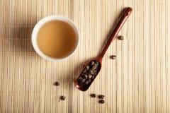 Green tea on a light bamboo mat. Toned Stock Images