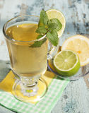 Green   tea with lime and mint. Stock Photos