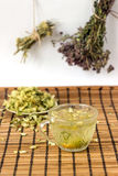 Green tea with linden flowers in a rustic style Royalty Free Stock Image