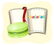 Green tea macaron and a book Stock Images