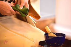 Green tea master caremony purification. Buddhism Matcha whisk green Japan Stock Image
