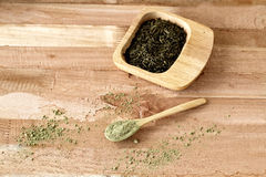 Green tea, a match tea, in wooden ware, natural ware. Royalty Free Stock Photo