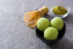 Green tea matcha ice cream scoops on gray stone Stock Photos