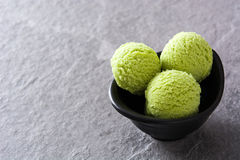 Green tea matcha ice cream scoops on gray stone Stock Image