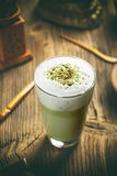 Green tea matcha latte. In a glass cup stock photography