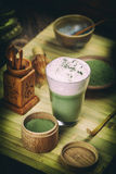 Green tea matcha latte. In a glass cup stock photo