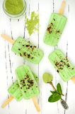 Green tea matcha mint popsicles with chocolate and coconut milk. Royalty Free Stock Photos