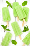 Green tea matcha mint popsicles with chocolate and coconut milk. Green tea matcha mint popsicles with chocolate and coconut milk Stock Images