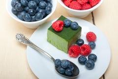 Green tea matcha mousse cake with berries Stock Photos
