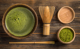 Green tea matcha. Top view of green tea matcha in a bowl on wooden surface Royalty Free Stock Photography