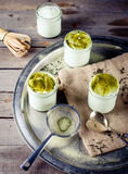 Green tea matcha yogurt, dessert in glass jars Royalty Free Stock Photography