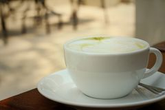 Green tea and milk at caffee shop. Stock Image