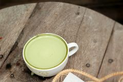 Green tea and milk for drinking Stock Photography