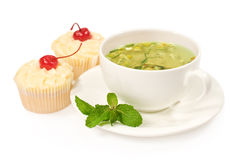 Green tea with mint and cake Royalty Free Stock Photo