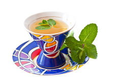 Green tea and mint in a cup. The cup of green tea whith mint on a white background Stock Photography