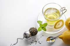 Green tea with mint and lemon with strainer top view Royalty Free Stock Images