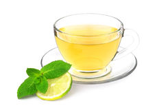 Green tea with mint and lime. A cup of green tea with mint sprig and slice of lime isolated on a white background royalty free stock photos
