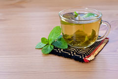Green tea with mint on wooden table Royalty Free Stock Photography