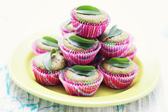 Green tea muffins. Homemade green tea muffins with green leaf - sweet food Stock Photo
