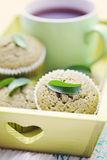 Green tea muffins. Homemade green tea muffins with green leaf - sweet food Royalty Free Stock Photos
