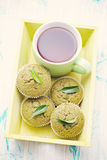 Green tea muffins. Homemade green tea muffins with green leaf - sweet food Stock Images