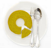 Green tea multiple layers cake on white disk Royalty Free Stock Photos