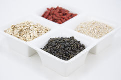 Green tea, oat and goji Stock Images