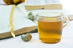 Green tea and the opened books. Green tea in the glass and the opened books Royalty Free Stock Photos