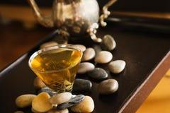 Green tea and pebble stones. Cup of green tea and pebble stones on the table Royalty Free Stock Photo