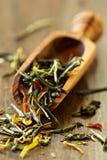 Green tea with pieces of carrot, marigold Royalty Free Stock Photos