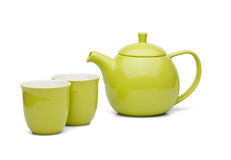 Tea pot with tea cups green set Stock Images