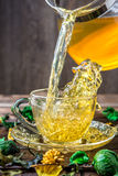 Green tea poured from teapot Royalty Free Stock Photos